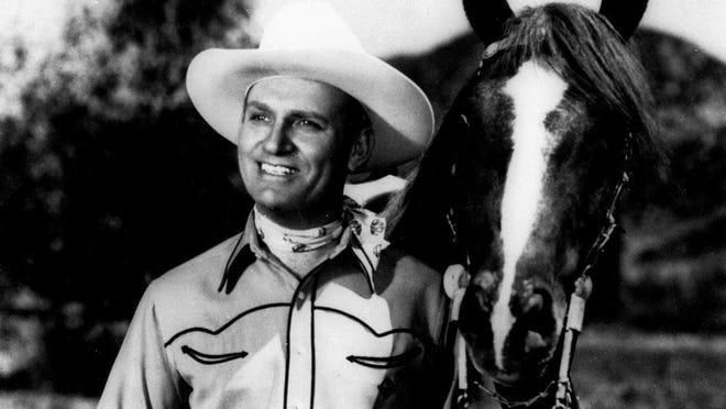 FILE--Actor Gene Autry is shown in this undated file photo. Autry, who parlayed a $5 mail order guitar into a career as Hollywood's first singing cowboy, died Friday, Oct. 2, 1998. He was 91. His death came less than three months after the death of his great rival, Roy Rogers. (AP Photo/File)