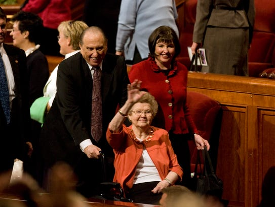Thomas Monson and his wife, Frances Monson, greet conference
