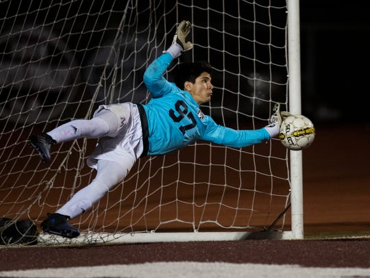 Veterans Memorial's Mark Pelaez saves a goal during