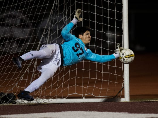 Veterans Memorial's Mark Pelaez saves a goal during a free kick during their game against Calallen on Tuesday, Feb.6, 2018 at Wildcat Stadium.