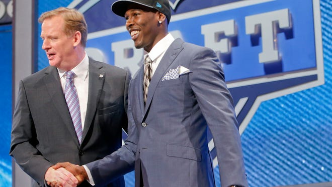 USC wide receiver Marqise Lee, right is greeted by NFL commissioner Roger Goodell  after being selected as the 39th pick by the Jacksonville Jaguars in the second round of the 2014 NFL Draft, Friday, May 9, 2014, in New York.