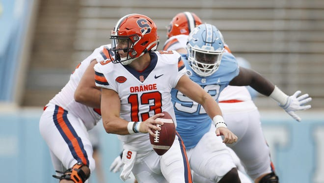 Syracuse quarterback Tommy DeVito (13) scrambles to avoid a North Carolina defender last week. DeVito was sacked seven times by North Carolina and faces another tough defense in Pittsburgh on Saturday.