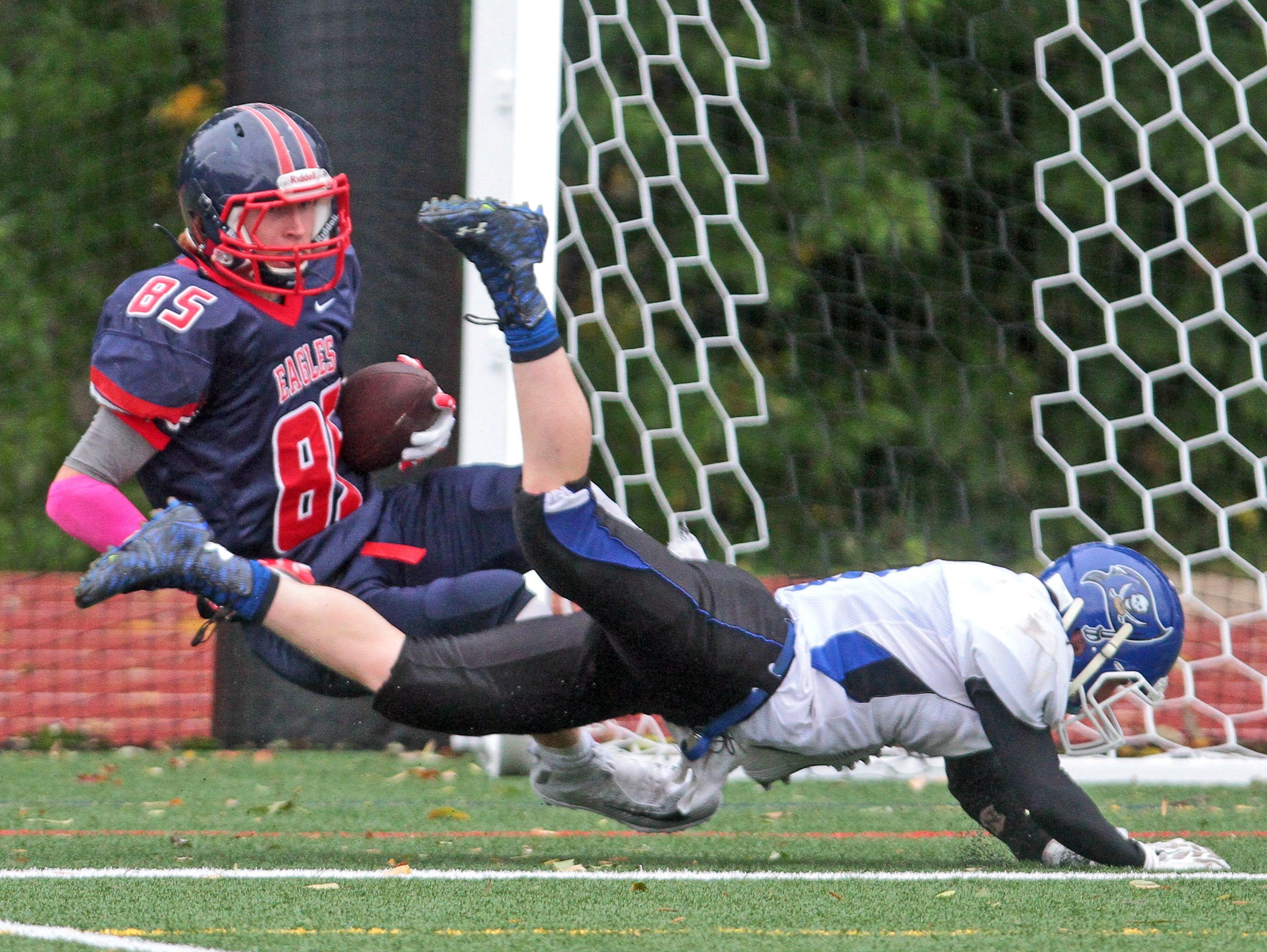 Eastchester's Andrew Shultz gets tangled up with Pearl River's Kyle Murphy in the end zone as he makes a touchdown reception during a varsity football game at Eastchester High School Oct. 3, 2015. Eastchester cruised to a 31-7 victory over Pearl River.