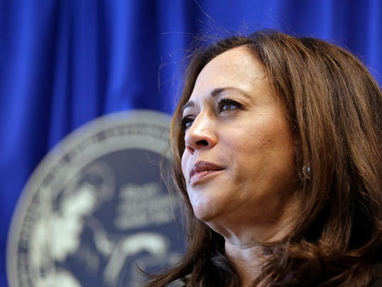 In this June 28, 2016 file photo, then California Attorney General Kamala Harris listens to questions during a news conference in San Francisco.