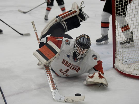Brother Rice's goaltender Ryan Hoffmann (1) dives for a save and finished with his second straight shutout Thursday against Novi.