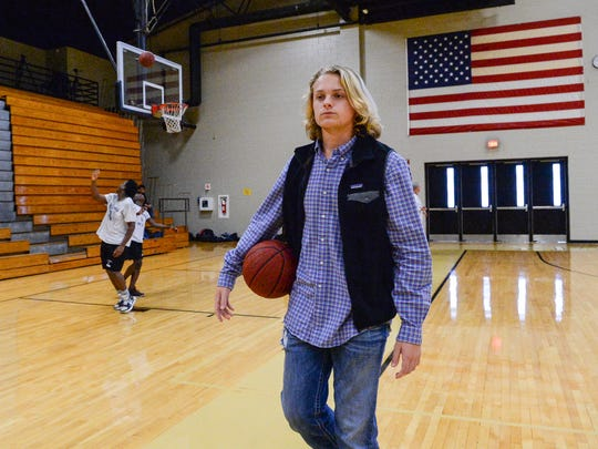 Clayton Pendergrass, a sophomore T.L. Hanna High School student visits the school gymnasium on the last day before Winter break. Pendergrass was revived at that spot on the court sidelines after going into cardiac arrest during a break in a game on November 20.