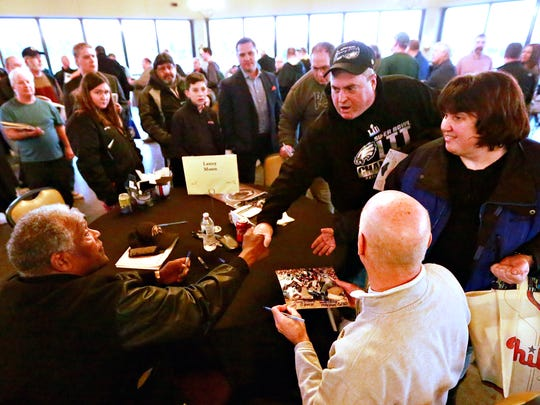 Former halfback and NFL Hall of Fame inductee Lenny Moore, 84, front left, provides autographs during the 54th Annual York Area Sports Night at Heritage Hills Golf Resort and Conference Center in York Township, Thursday, Feb. 8, 2018. The 55th edition of the show is set for Thursday, April 4. Dawn J. Sagert photo