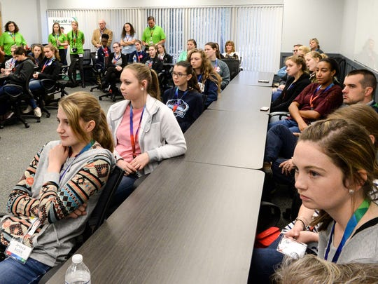 Jessica Brock, left, and Katalee Callahan, right, both of Palmetto High School, listen to a speaker during the STEM4SUCCESS event at Bosch in Anderson on Wednesday. A group of 32 Anderson County high school sophomore girls interacted with professionals from the plant to learn about the jobs which use skills learned in science, technology, engineering and mathematics.