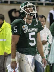MSU's Drew Stanton leaves the field dejected after