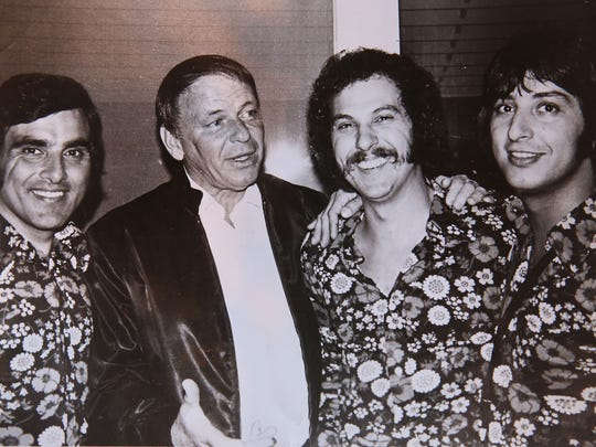 Pat Rizzo, right, and other members of the Cuff Links take a photograph with Frank Sinatra.
