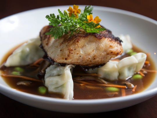 At Restaurant 618, miso cod is served atop edamame