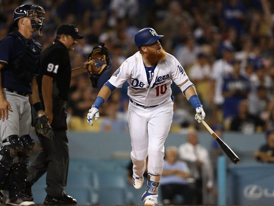 Justin Turner of the Dodgers watches his two-run homer