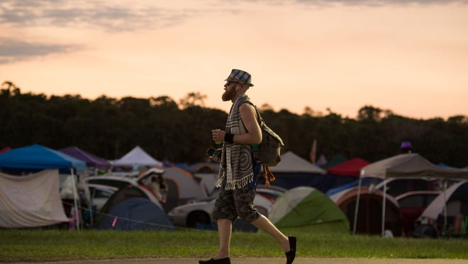 People attend the second day of the Okeechobee Music & Arts Festival on Friday, March, 2, 2018, at Sunshine Grove in Okeechobee County. The third annual festival continues through Sunday.