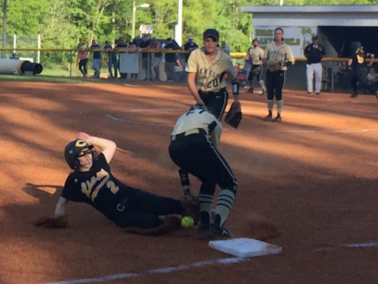 Lady Rebel shortstop SarahAnn Page (21) covers third