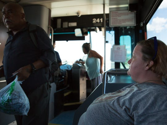 """Valerie Chronister rides the Las Cruces Roadrunner Transit, July 22, 2016. Valerie uses the bus system daily and believes the change in bus routes will cause it to be """"loco in the coco"""". The Roadrunner Transit will have changed bus routes starting Monday July 21, 2016."""