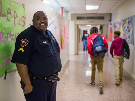 Cpl. Jarvis Mayfield of the Lafayette Police Department watches a hallway during a class change at Paul Breaux Middle in November 2015. Mayfield is one of several police who have worked as school resource officers in Lafayette Parish.