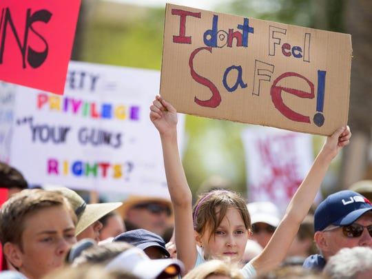Mila Kaye, 9, of Phoenix, Arizona, supports gun control during the March For Our Lives in Phoenix on March 24, 2018.