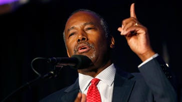 Trump taps Carson for HUD, feuds with China