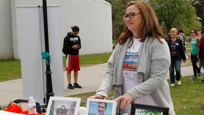 Margaret Valsechi from Lindhurst stands with a picture of her son, Stephen who was an organ donor as she shares his story during Rockland Community College's special health and donor awareness event featuring the Big Idaho Potato Truck on Thursday, April 28, 2016.