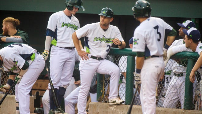Lake Monsters Manager Aaron Nieckula, center, leads his team against the Hudson Valley Renegades at Centennial Field in Burlington on Friday, July 7, 2017.