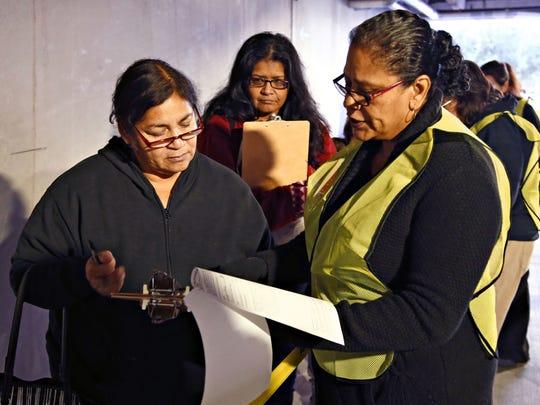 Darlene Ramirez (left) gets assistance completing an