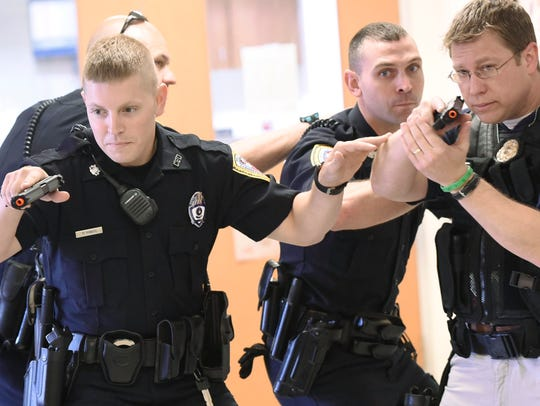 Chambersburg Police enter the hallway to conduct an