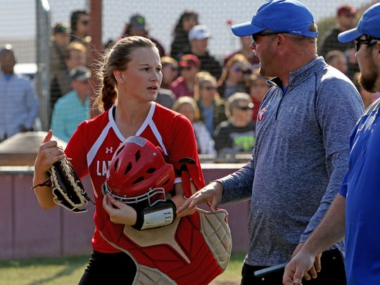 Graham's Callie Dobbs talks with head coach Adam Arrington after taking over for Nicole King behind the plate in the game against Vernon Friday, April 20, 2018, in Vernon.