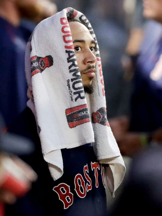 Boston Red Sox right fielder Mookie Betts watches in the dugout during the third inning of a baseball game against the Los Angeles Angels in Anaheim, Calif., Friday, July 21, 2017. (AP Photo/Chris Carlson)
