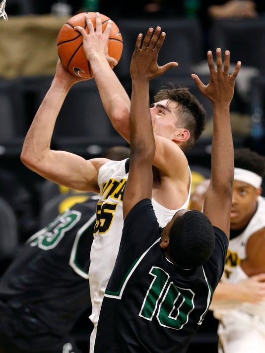 Iowa forward Luka Garza shoots over Chicago State guard Anthony Harris (10) during the second half of an NCAA college basketball game, Friday, Nov. 10, 2017, in Iowa City, Iowa. (AP Photo/Charlie Neibergall)