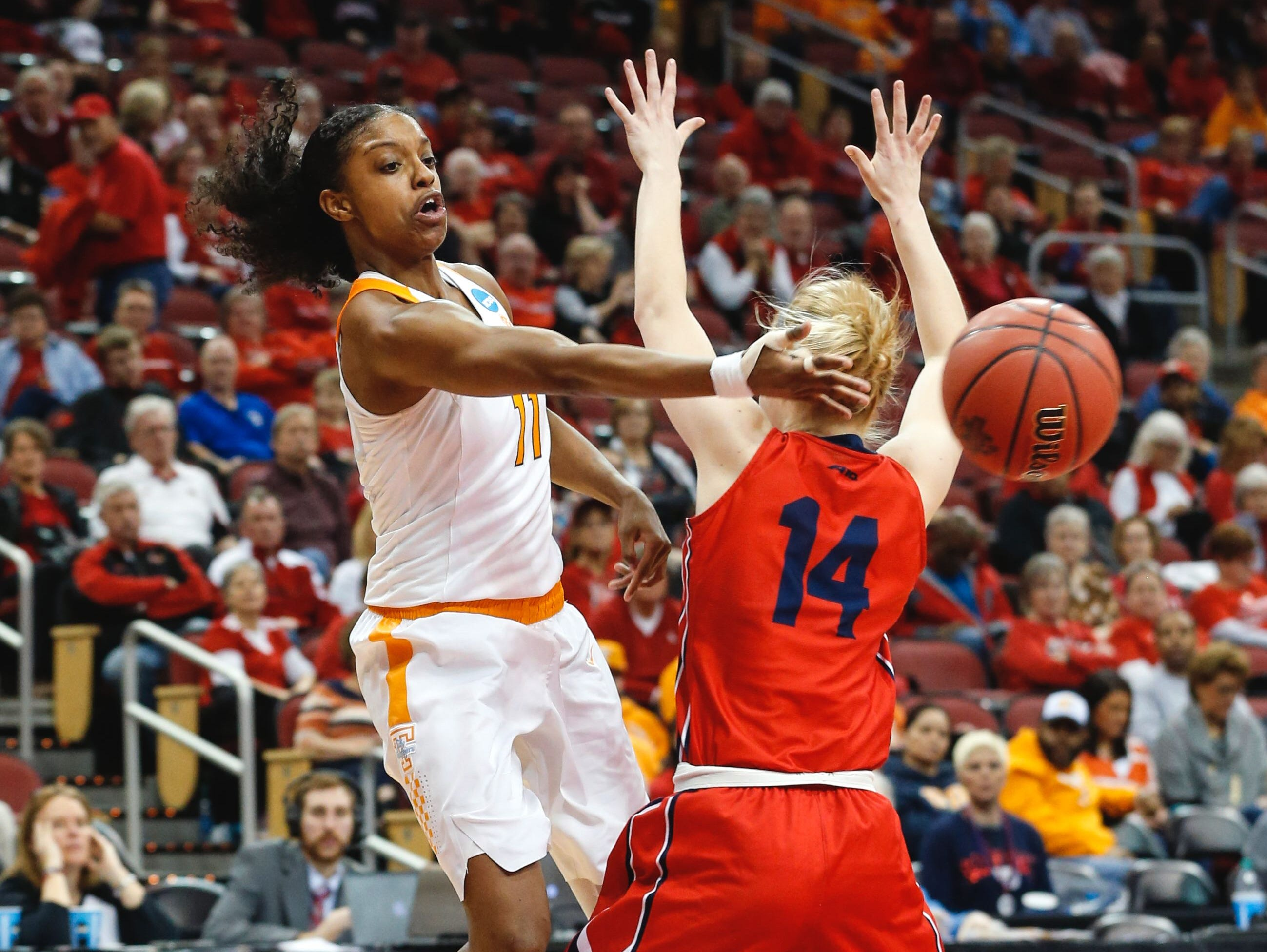 Tennessee's Diamond DeShields whips a pass around Dayton's Jenna Burdette during the first round of the NCAA women's basketball tournament on Saturday, March 18, in Louisville, Ky.