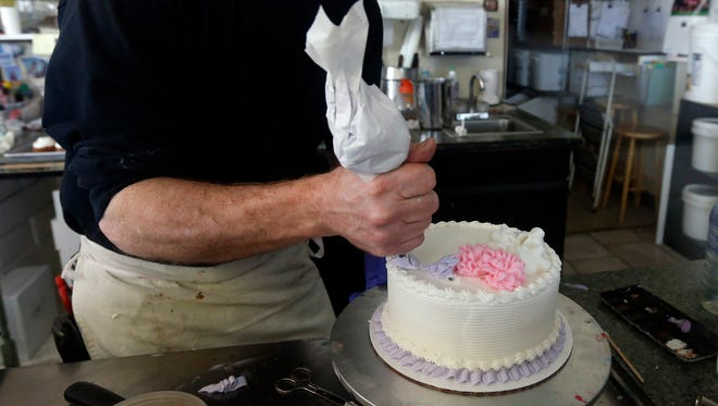 Masterpiece Cakeshop owner Jack Phillips on March 10, 2014, decorates a cake inside his store in Lakewood, Colo. Colorado's Civil Rights Commission recently upheld a judge's ruling that Phillips cannot refuse to make wedding cakes for same-sex couples, despite Phillips' cited religious opposition to same-sex marriage.