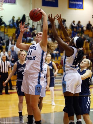 Morris Catholic's Emma Duerr goes up for a rebound vs. Chatham during the Morris County Tournament girls basketball semifinals at the County College of Morris. February 16, 2018. Randolph, NJ.