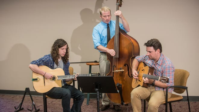 From left, Matthew Clements, Corey Martin and Matt Strickland of the group Gypsy Cornbread perform gypsy jazz music Aug. 22, 2016, at the Montgomery Advertiser.