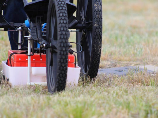 The ground penetrating radar is walked over a site in a precise grid pattern to create a picture of objects buried underground.