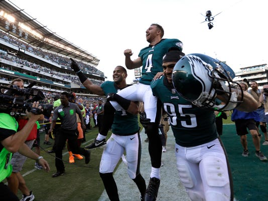 Philadelphia Eagles' Jake Elliott (4) is carried off the field after kicking an NFL football game-winning field goal against the New York Giants, Sunday, Sept. 24, 2017, in Philadelphia. (AP Photo/Michael Perez)