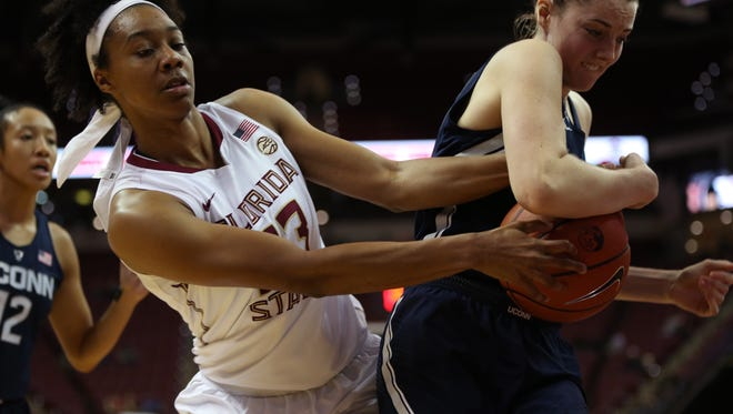 FSU's Ivey Slaughter fights Connecticut's Katie Lou Samuelson for a rebound during their game at the Tucker Civic Center on Monday, Nov. 14, 2016.