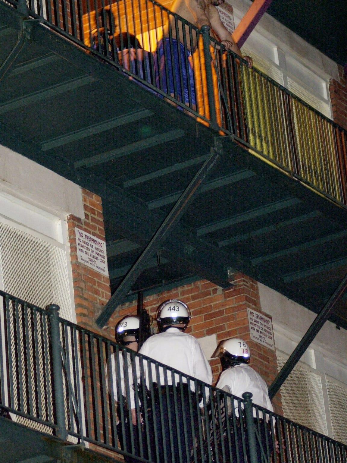 Cincinnati Police Officers leave a second floor apartment