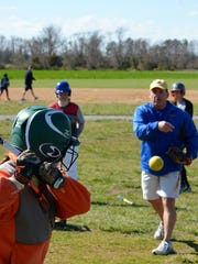 Sussex Central High School softball coach John Wells throws batting practice to his student athletes during practice Monday, March 21.