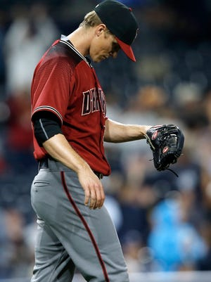 Arizona Diamondbacks starting pitcher Zack Greinke looks down after San Diego Padres' Erick Aybar hit a solo home run during the eighth inning of a baseball game in San Diego, Wednesday, April 19, 2017.