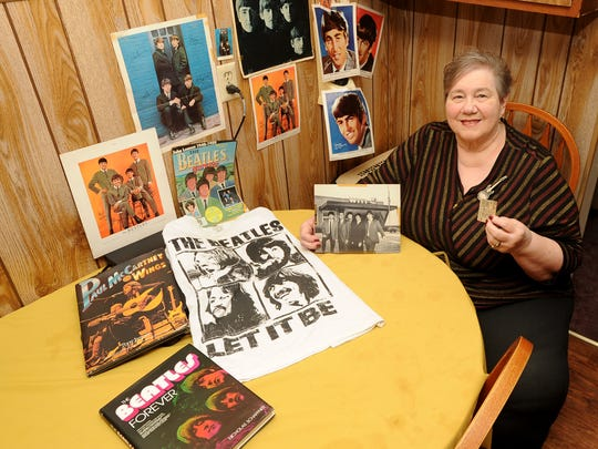Pat Stephany of Fond du Lac displays part of her Beatles collection which includes a copy of the ticket stub from a Beatles concert she attended in Milwaukee on Sept. 4, 1964. It would be the only time The Beatles would play in Milwaukee. She says to this day she is still in love with Paul McCartney.