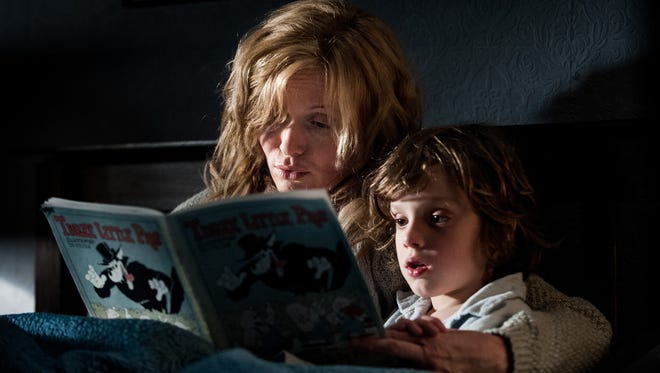 "Noah Wiseman and Essie Davis in a scene from the motion picture ""The Babadook."""