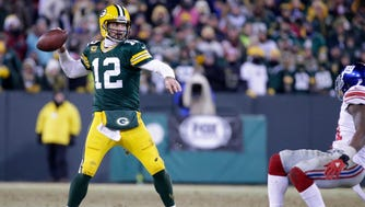 Green Bay Packers quarterback Aaron Rodgers looks to pass against the New York Giants at Lambeau Field.