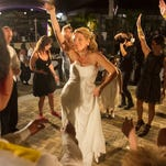 Shelly Osterhout, center, dances at her wedding reception on Saturday, October 10, 2015, in Fort Myers. Osterhout and Lee Co. Deputy Paul Johnson invited strangers to their wedding reception at Bell Tower Shops.