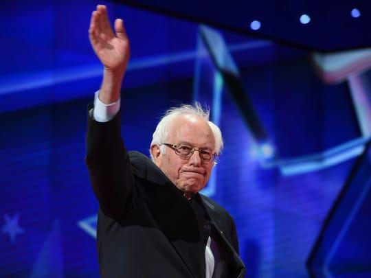 Bernie Sanders arrives on stage for the CNN debate