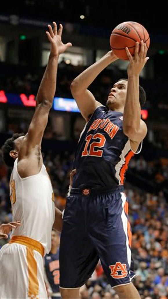 Auburn's Tyler Harris (12) shoots over Tennessee's Derek Reese (23) during the first half of an NCAA college basketball game in the Southeastern Conference tournament in Nashville, Tenn., Wednesday, March 9, 2016.