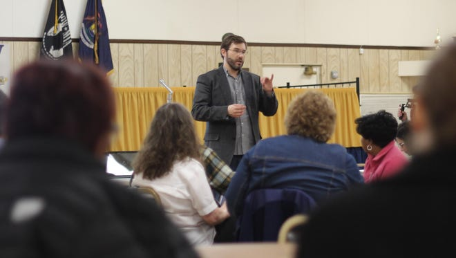Ryan Bates, executive director of Michigan United presented how local houses of worship could become sanctuary places.