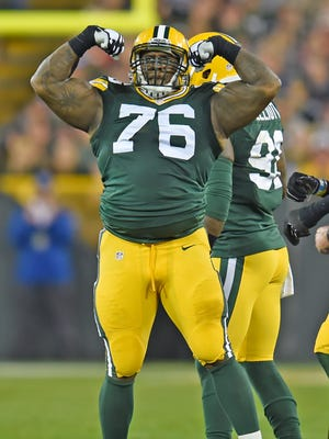 Green Bay Packers defensive end Mike Daniels (76) celebrates a defensive stop against the Kansas City Chiefs at Lambeau Field.