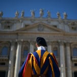A Swiss guard stands at attention during a Valentine's Day celebration in St Peter's square at the Vatican on February 14, 2014.