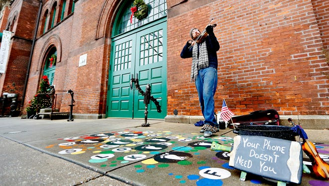 """Street Performer Ian Carroll, of York City, plays, """"Mountain Road"""" outside of Central Market in York City, Thursday, Dec. 29, 2016. Dawn J. Sagert photo"""