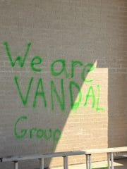'We are VANDAL Group' was spray painted on an exterior